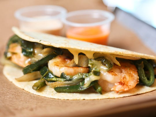 The shrimp taco from MexA Steak Tacos has cheese, grilled poblano, peppers, grilled onion and grilled shrimp in a corn tortilla.