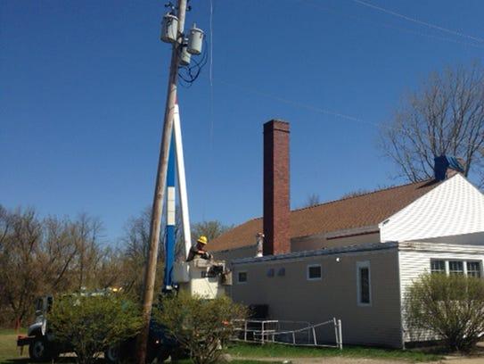 Consumers Energy workers begin to repair a line broken