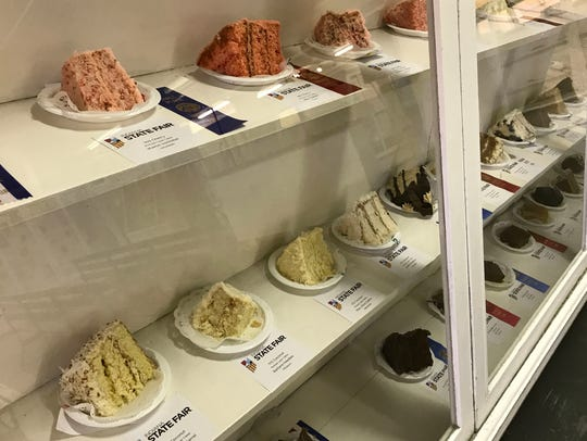 Pies and other baked goods are on display behind glass