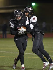 Charger Avery Grenier (12) takes the handoff from quarterback