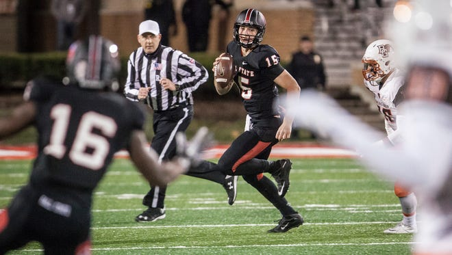 Ball State's Riley Neal looks for KeVonn Mabon  in the Cardinals' last game of the season against Bowling Green on Nov. 24, 2015.