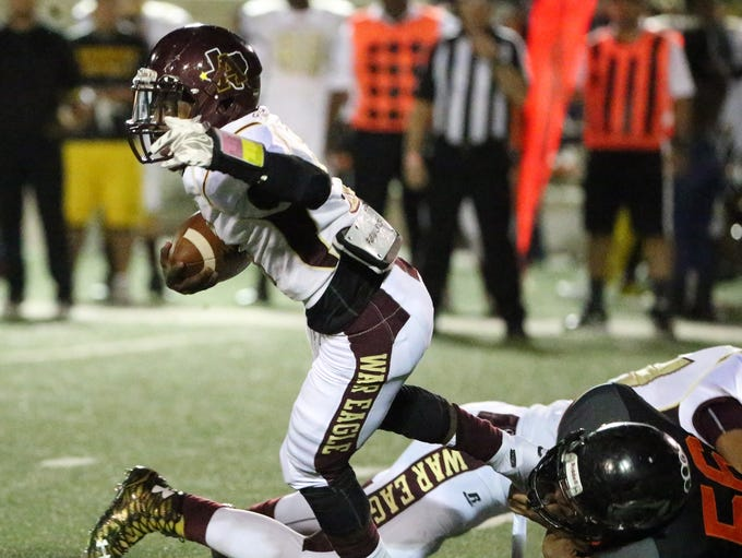 Andress running back Robert Wiggins, 5, is tripped