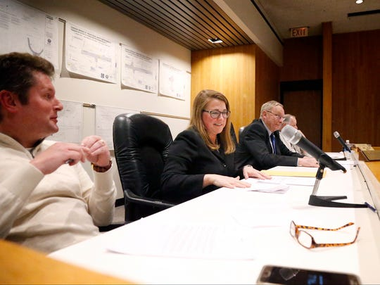 Michelle Beckman situates herself in her seat on the Corning council Monday between First Ward councilman Steven Maio and Seventh Ward councilman James Nelson after being voted into office moments beforehand.