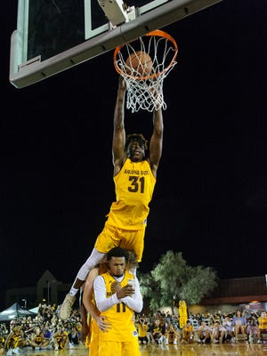 Arizona State University's Zylan Cheatham (#31) goes over his teammates for his second slam first slam dunk during Mill Madness on Friday, Oct.13, 2017, at Mill Avenue & 7th St. in Tempe, Ariz.