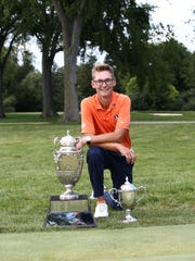Dylan Meyer poses with the Western Amateur Championship trophy after winning the title on Aug. 6.