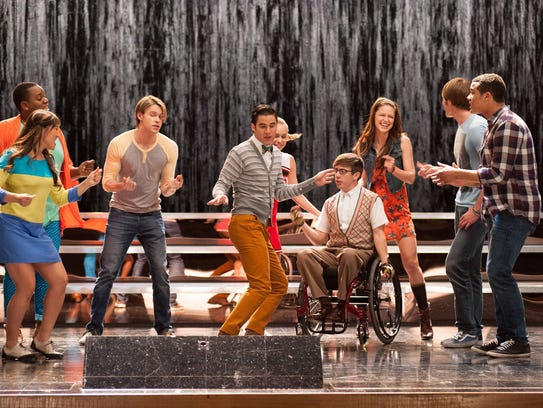Darren Criss, center, first gained fame playing Blaine