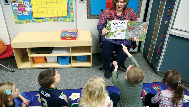 Virginia Woeste reads a story for her kindergarten class at PineCrest Elementary in Central Kitsap.