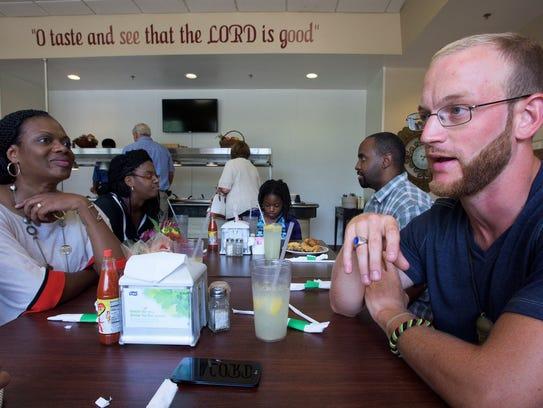 Francisco Pucciarello has lunch with pastors Bessie