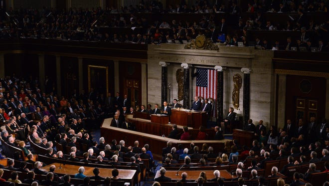 President Obama delivers his 6th State of the Union address before a joint session of Congress in Washington, DC, USA. Congress must preserve constitutional limits on the president's power by narrowing his authorization of force request.