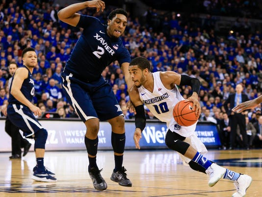 Creighton's Maurice Watson Jr. (10) drives around Xavier's James Farr (2) during the second half of an NCAA college basketball game in Omaha, Neb., Tuesday, Feb. 9, 2016. Creighton won 70-56. (AP Photo/Nati Harnik)