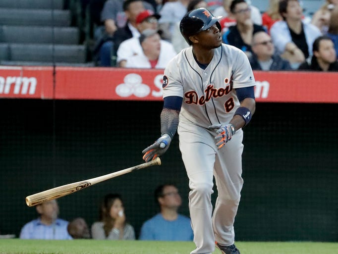 Detroit Tigers' Justin Upton watches his three-run