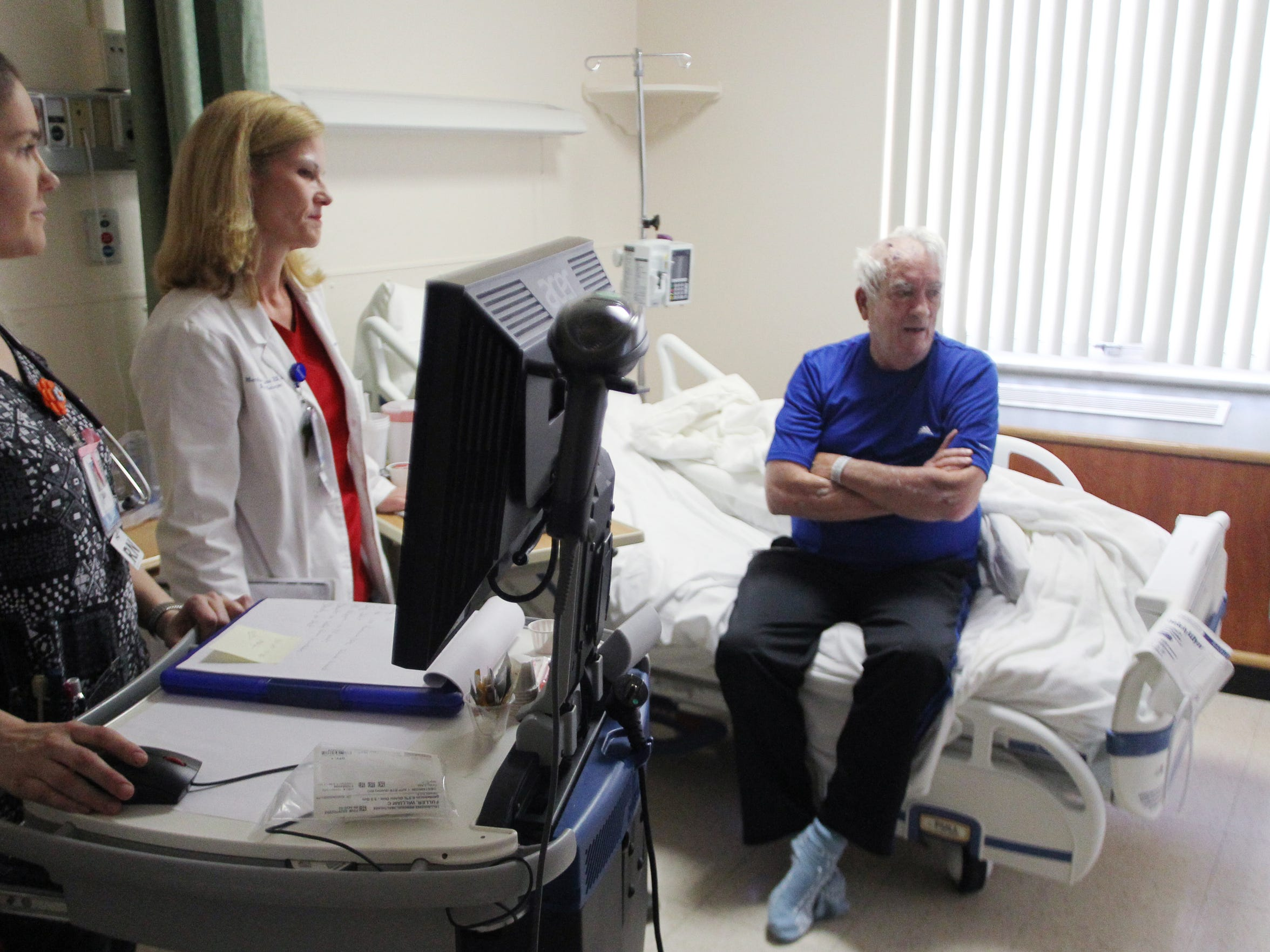 Nurses talk with Tallahassee Memorial Hospital patient Bill Fuller. Nationally, nursing is a high-demand profession wrought with vacancies.