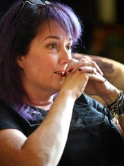 Popular urban fantasy author Sherrilyn Kenyon bites