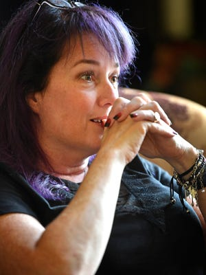 Popular urban fantasy author Sherrilyn Kenyon bites her nails as she talks about growing up poor and eventually becoming a homeless mom. Friday June 15, 2018, in Franklin, Tenn.