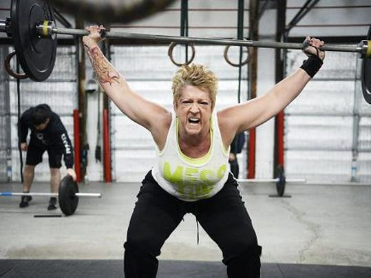 Photo by Kate Penn; Missy Hornberger of Springettsbury Township does a snatch, an olympic lift, during a recent workout at Crossfit York.
