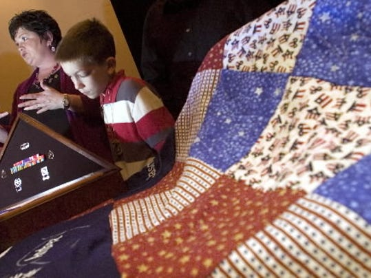 Donna Cutchall, of Dover, and son Logan attended a ceremony last year to accept the Quilt of Valor from Spring Grove Area Middle School. The quilt was made in honor of Staff Sgt. Christopher Cutchall, who was killed in Iraq in 2003.