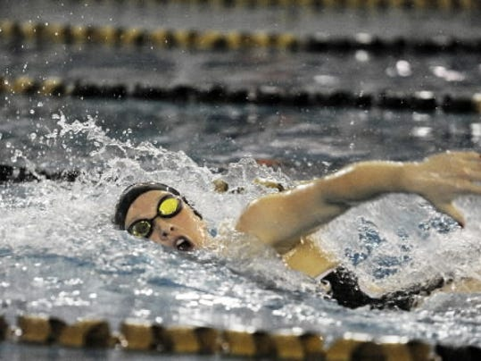 Morgan Pfaff swimming with Red Lion.