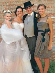 Rachel and Garth Godden renewed their vows a couple weeks before he died. Also pictured are Harlo and Péli.