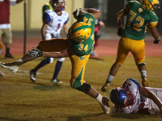 Coachella Valley's Romero Martinez carries the ball into the end zone to score again Indio in the first quarter during the Bell Game on Friday, September 16, 2016 in Thermal.