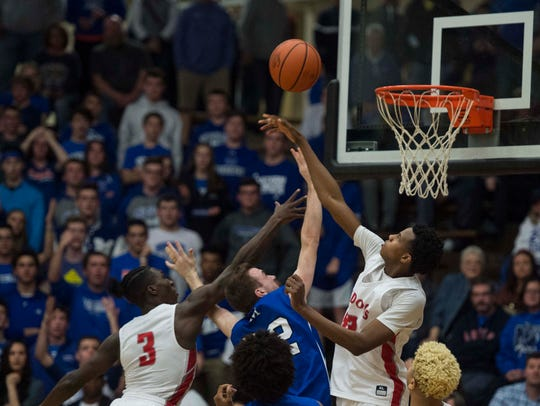 Bosse's Kiyron Powell (52) blocks a shot by Memorial's Andrew Cross in the Bulldogs' win in the Class 3A Boonville Sectional title game.