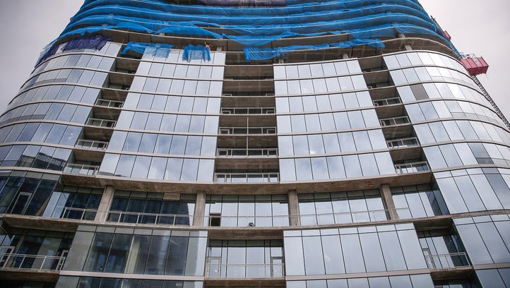 Construction continues on 360 Market Square, the apartment tower going up at 360 E. Market St. in Indianapolis, on Tuesday, March 28, 2017. Tony Siino, who is installing the glass on the exterior of the building and a contractor for Reflection Window & Wall, said each floor of the 26-floor building has 150 glass panels making up its outer walls.
