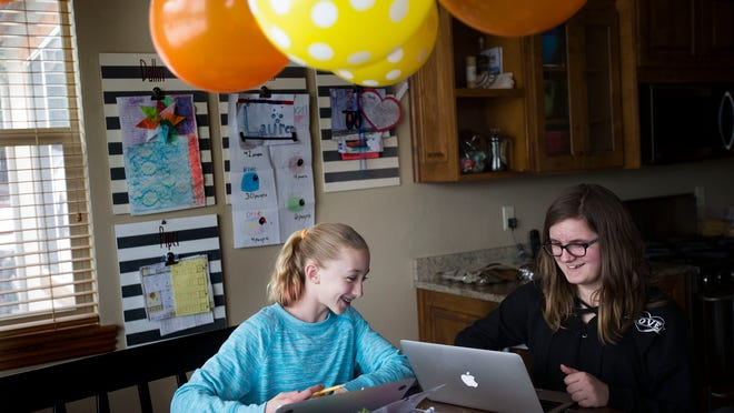 Lauren Greenwell and Emery Nelson color after school at the Greenwell's home in Park City on Friday, March 16, 2018.