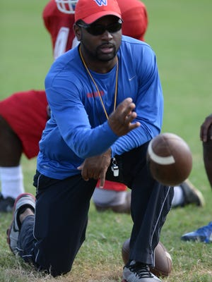 Woodlawn coach Jerwin Wilson and the Knights could make a bold statement with a win at Haughton.