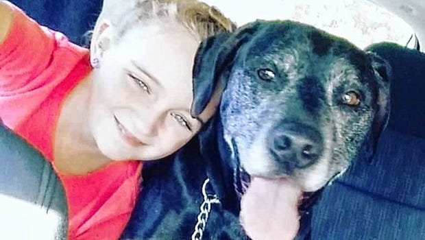 Kaelynne Driscoll and her dog, Ditch. Driscoll, who was in a boating accident in July, will receive half of the proceeds from the McLean Fire Department's first Hero's Challenge on Oct. 15.