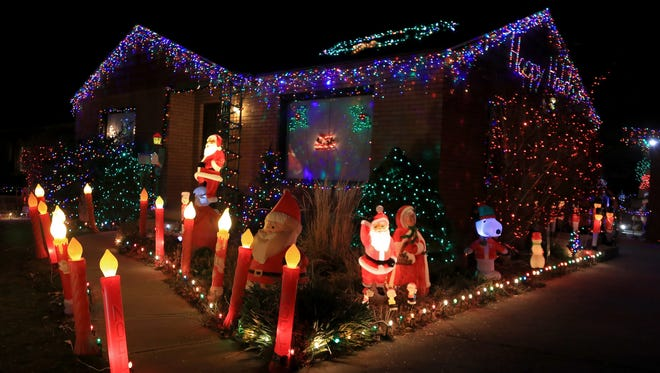 This delightful home at 26 N. 1150 West, Cedar City, invites visitors to walk around the light display in the front and back yards.