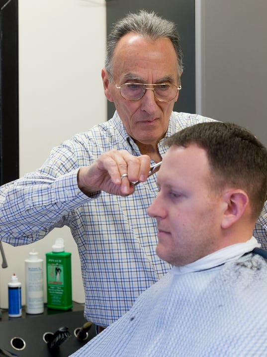Barber Shop Ithaca : of Ithaca, gives Matthew Sledjeski, of Groton, a hair cut in his shop ...