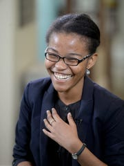 Earlham College student Leslie Ossete laughs while