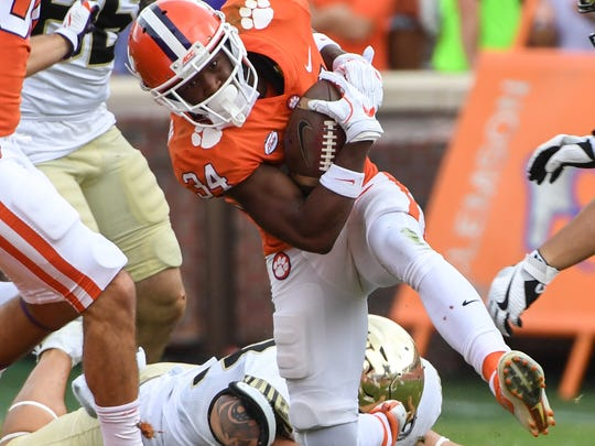Clemson wide receiver Ray-Ray McCloud (34) returns a punt against Wake Forest during the third quarter in Memorial Stadium at Clemson on Saturday.