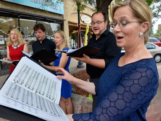 """St. Cloud-based singing group the Five Good Reasons Quintet sings the spiritual """"In Dat Great Gittin' Up Mornin'"""" during the St. Cloud Art Crawl on Friday, Aug. 22."""