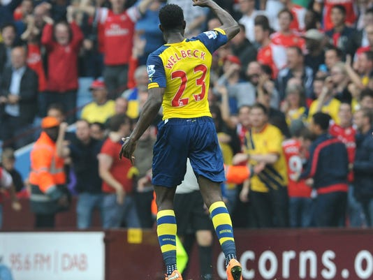 Arsenal's Danny Welbeck celebrates scoring against Villa during the English Premier League soccer match between Aston Villa and Arsenal at Villa Park, Birmingham, England, Saturday, Sept. 20, 2014. (AP Photo/Rui Vieira)