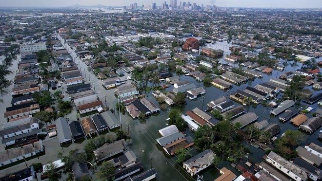 """This aerial photo shows the devastation caused by the high winds and heavy flooding in the greater New Orleans area following Hurricane Katrina Tuesday, Aug. 30, 2005 in Louisiana. Katrina is one of the disasters examined in """"Nature Unleashed"""" at the Pink Palace Museum. (AP Photo/ Vincent Laforet, POOL)"""