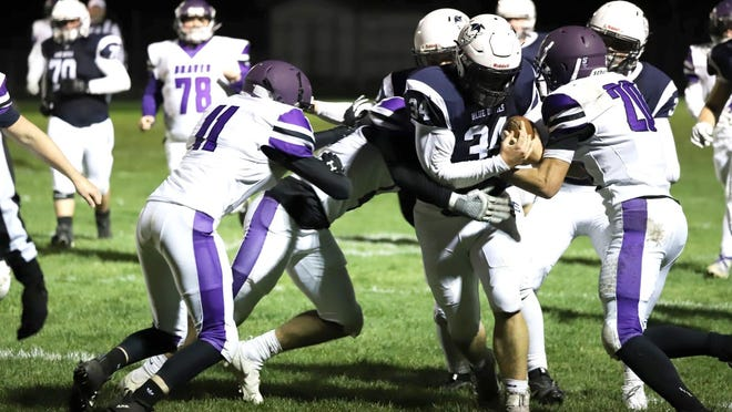 Sault High's Ryan Laplaunt (34) carries the ball during a game against Gladstone last week. The Blue Devils are at home again, as they play host to Benzie Central this Friday night.