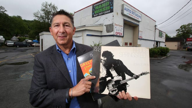 Michael Magnone of New City with his copies of Bruce Springsteen's first three albums at the Blauvelt Auto Spa . Magnone wants to put up a historical marker at the site, originally the 914 Sound Studios, where the first two albums and the title track of the third were recorded.