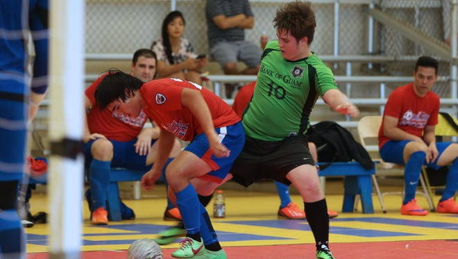 Bank of Guam Strykers' Scott Spindel tries to kick the ball loose away from Quality Distributors' Jared Pangindinan on opening day of the 2017 Budweiser Men's Futsal League Sunday afternoon at the Guam Sports Complex gym in Harmon. The Strykers and Quality battled to a 7-7 draw.