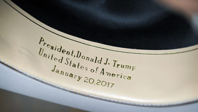 Gold embossing distinguishes a hat made by the American Hat Company in Bowie as one made by request for President-elect Donald Trump. The 101-year-old hat company makes a wide variety of straw and felt cowboy hats.