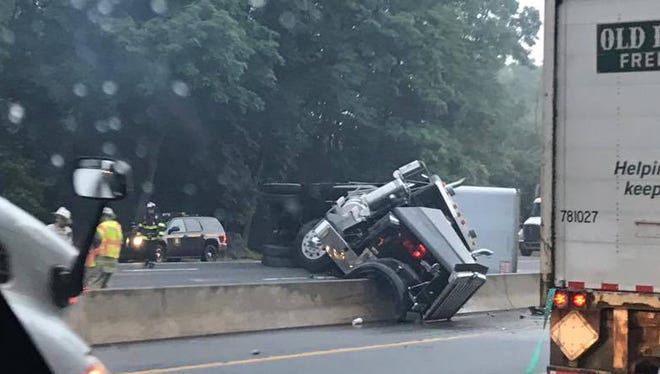 A tractor-trailer has overturned on the Cross Westchester, I-287 westbound, shutting all lanes on Tuesday, July 11, 2017.