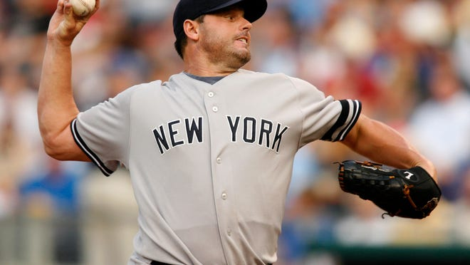 Yankees starting pitcher Roger Clemens throws a pitch against the Royals on July 23, 2007.