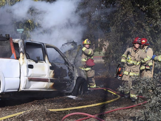 Visalia firefighters extinguish a truck fire Friday