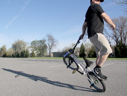 Pictured is a flatland freestyle BMX move. Parking