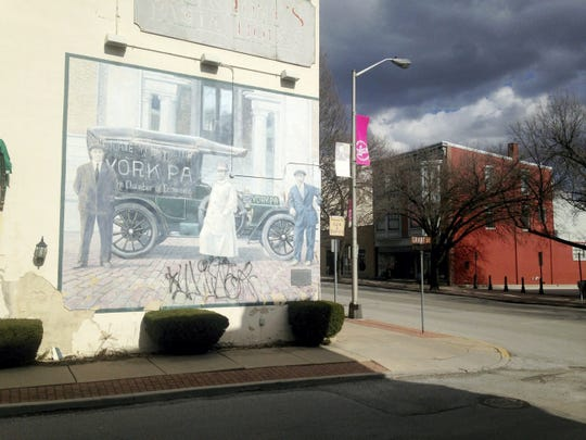 The Murals of York could become ghost signs of a kind. The 18 panels were not designed or prepared to last forever, and many are showing wear and tear at the 20 year mark. This mural, celebrating the making of Pullman vehicles in York, is among those showing the most deterioration. And this one was vandalized (since repaired), to boot. The York County History Center is looking for groups or individuals who will adopt a mural and underwrite its restoration.