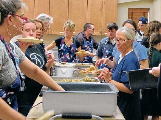 In this 2014 file photo, volunteers at Our Savior Lutheran Church serve up Thanksgiving dinner for the community. The church and Otero Hunger Coalition served up to 100 people.