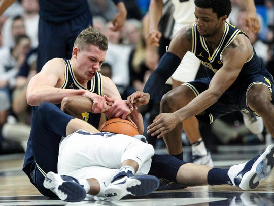 Moritz Wagner fights for a loose ball against Penn State on Wednesday.