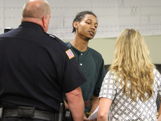 Demar S. Reevey, 23, of Red Bank, charged in connection with the stabbing death of Red Bank firefighter Andrew Hill, 26, speaks with his public defender after his first appearance before Judge David Bauman in Freehold Tuesday, May 29, 2018.