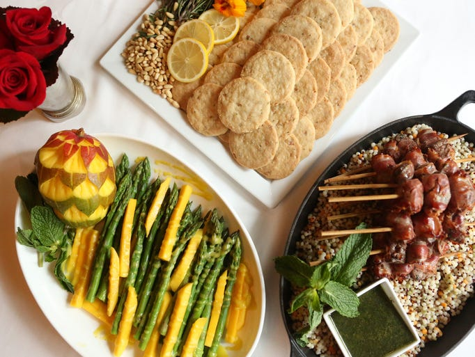 Clockwise from right, lamb and pancetta brochettes with mint pesto, mango and asparagus salad and lemon and rosemary shortbread cookies  at The Seelbach Hilton. Apr. 2, 2014.
