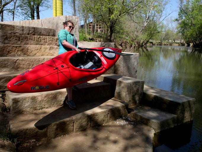 Katy Tucker is seen putting her kayak in at Creekside Paddling access point on Floyds Fork. April 23, 2014