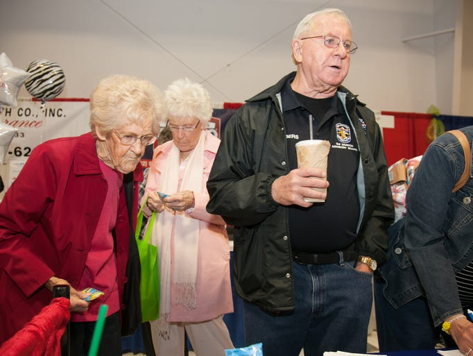 Lou Conway, left, Dot Fow, and Jim Chambers visit a booth at the 13th annual Discover Dixie Business Showcase Expo held at Incarnation Catholic Church. May 15, 2014